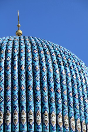crescent moon: Tiled dome of a mosque with a golden crescent moon on a clear sky frne