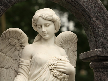 mournful: mournful angel with with a female face Stock Photo