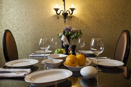 sconces: table setting awaits the guests