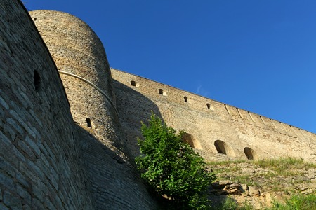 tower and  fortress wall view from the bottom up Ivangorod  Russia