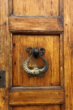 durable: Polished old durable brass door knocker