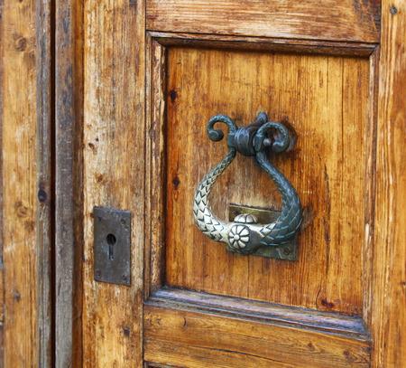durable: old durable brass door knocker Stock Photo