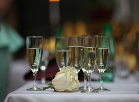 wine glasses: flower rose and glasses with white wine