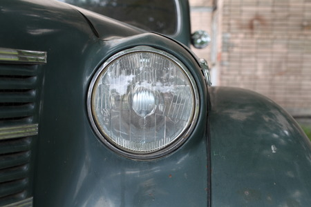 headlight: headlight of Vintage car Moskvich-400 front view