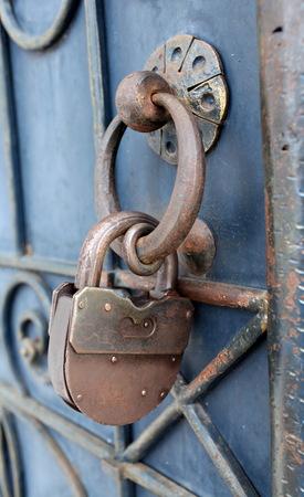 large doors: Old rusty padlock Stock Photo
