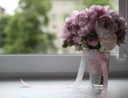 windowsill: Bouquet with ribbon on a windowsill