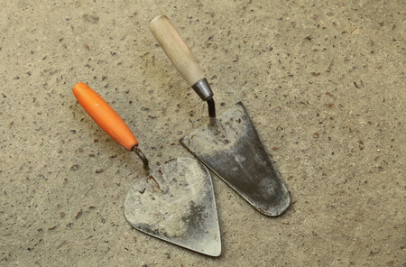 bricklayer: tools for bricklayer  old masonry trowels Stock Photo