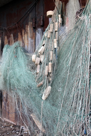 fishing floats: fishing net with floats drying on the wall