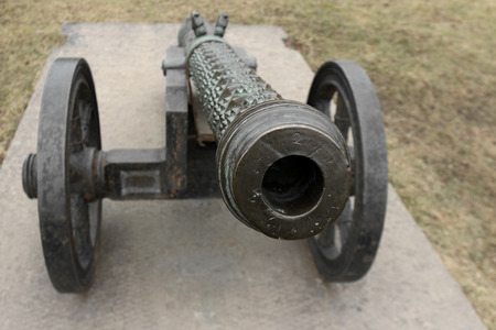 cannon gun: old medieval bronze cannon on the gun carriage front view