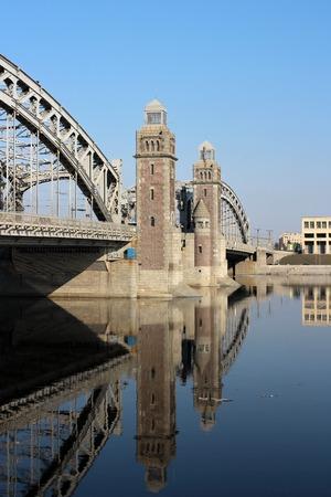 and st petersburg: Bridge Peter Great in St. Petersburg reflected in water