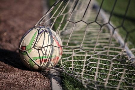 scored: football ball scored into the net gate