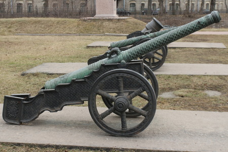 cannon gun: old medieval bronze cannon on the gun carriage