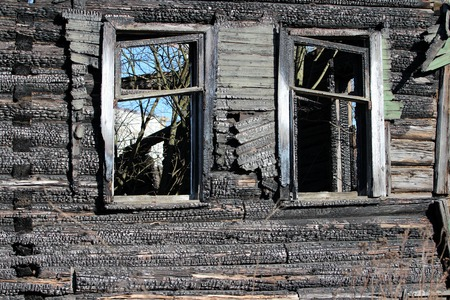 empty window Burnt old wooden house