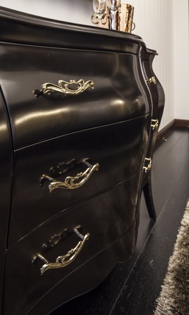 highboy: Chest of drawers ebony with gold handles