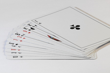 fanned: playing cards fanned out isolated on white background