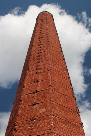 tall chimney: industrial chimney of red brick against a blue sky