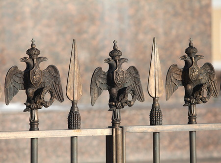 fence decorations with Russian  Double Headed Eagle close to