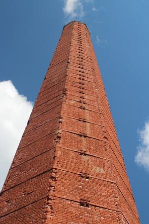 high smokestack of red brick hexagon