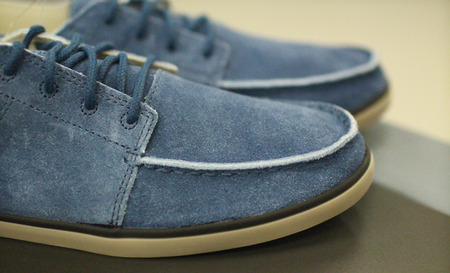 pair of blue suede shoes for men shallow depth of field Stock Photo