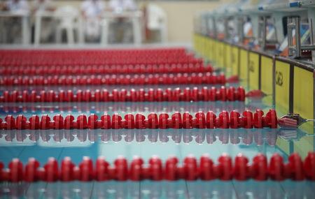 lane marker: red lane marker  empty swimming pool close to