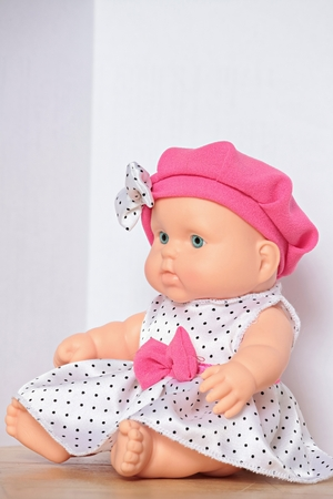 doll with pink bow close to