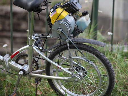 economic cycle: homemade, bicycle with a motor of the lawnmower, fragment