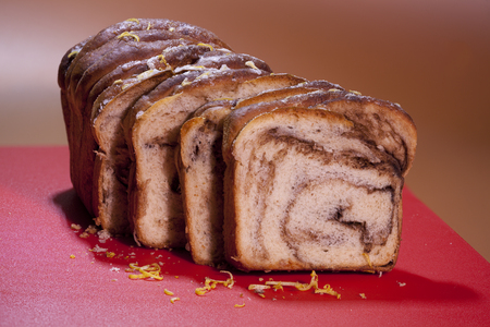 cut up  pieces of  loaf sweet bread with cinnamon, freshly baked