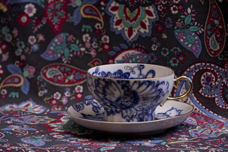 Beautiful cup with saucer porcelain, Blue gold floral, oriental pattern Stock Photo
