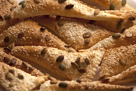 flaky Triangles  puff pastry Sprinkle Seeds pumpkin, sesame seeds, background