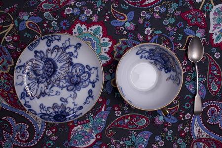 tea cup saucer porcelain Blue gold floral pattern overhead view