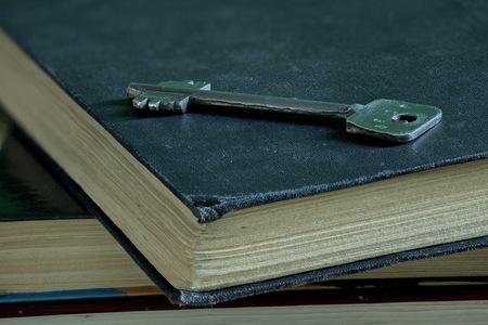 concealment: Iron key and old book Concept education discovery Knowledge wisdom