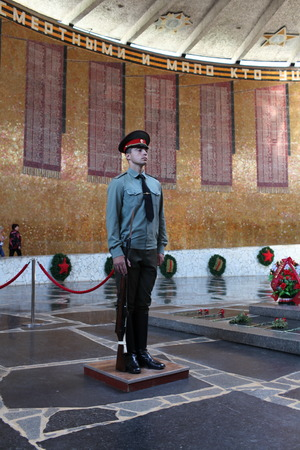 Volgograd Russia ,August 28, 2013 soldier stands guard at  eternal fire in honor of  victims of the Battle of Stalingrad