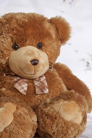 endear: Smiles teddy bear plush friend, cute toy Stock Photo