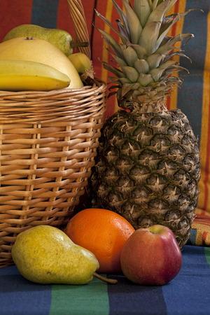 basket full fruit symbol of abundance and prosperity still-life Lizenzfreie Bilder