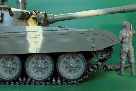 commander in overalls and a helmet standing at battle tank Lizenzfreie Bilder