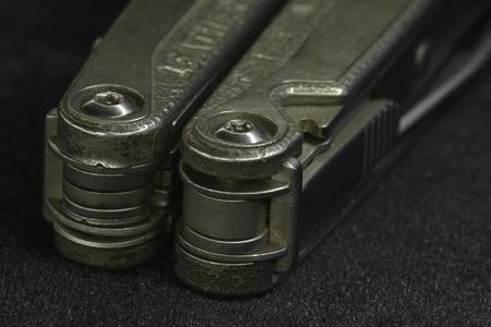 versatile: multitool Steel knife macro shot Stock Photo