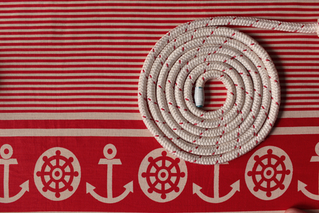 Rope round spiral red striped  flat lay Marine background Stock Photo