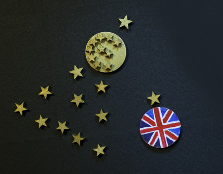 Christmas tree with euro coin and British coin, Brexit disintegrationconcept