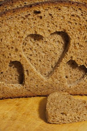 piece rough rye bread with hearts Standard-Bild
