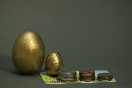 stack of coins and golden eggs growing