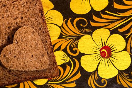 rye bread in shape of a heart  cutting board