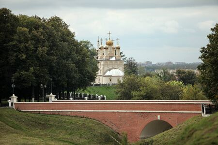 Ryazan Russia September 10, 2013 christian church on high river bank,stone bridge red brick