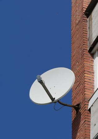 satellite antenna on the wall of the house