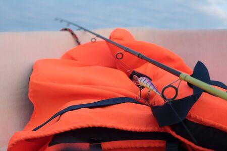 fishing rod on fishing and lifejacket is necessary when catching predatory fish in the sea