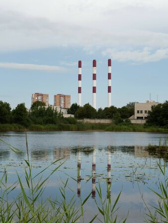 high chimneys of a power plant industrial landscape