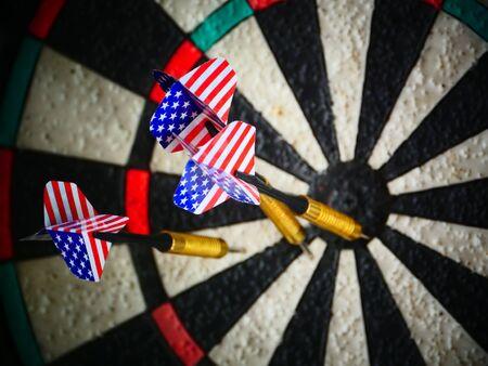American darts arrows in target darts close to Banco de Imagens - 128825604
