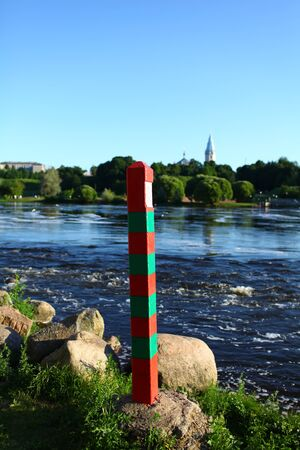 Russian frontier pillar by the river