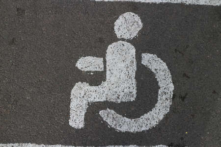 person in a wheelchair road sign close-up Standard-Bild