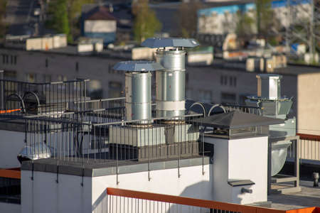 ventilation pipes on the roof of a high-rise building high angle view Standard-Bild