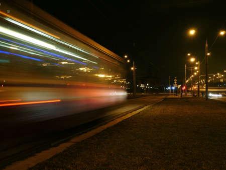 tram motion blur night light trails Standard-Bild